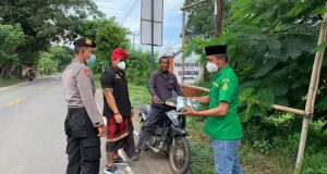 Ansor, Banser, dan LPBINU Desa Pemuteran Bersama Aparat Desa Lakukan Edukasi Masyarakat Cegah Covid-19